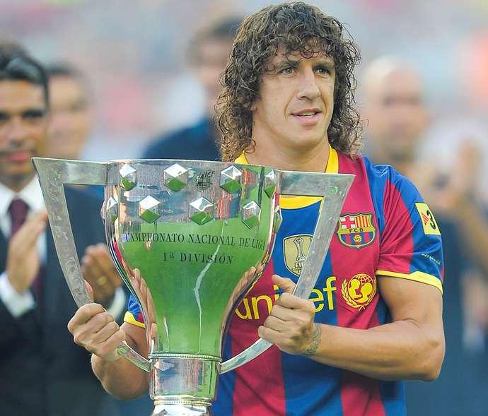 Barcelona's capitain Carles Puyol celebr